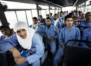 Slave workers in Dubai being transported to their temporary homes outside of the city