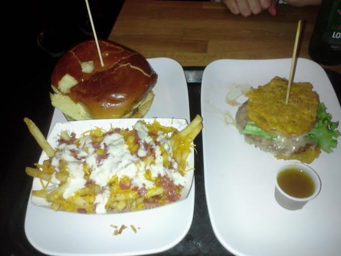 Pincho Burger and Bacon Cheddar Fries (Left) Toston Burger (Right)