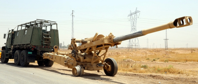 Islamic State Militants hauling away abandoned military equipment